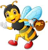 拿着罐蜂蜜的动画片蜂 图库摄影