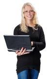 拿着膝上型计算机的年轻白肤金发的女商人佩带的玻璃 库存图片