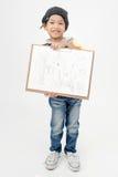 拿着艺术委员会的愉快的亚裔男孩 免版税库存图片