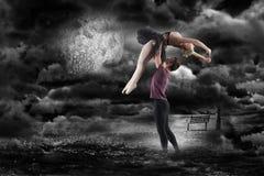 拿着芭蕾舞女演员的人的综合图象 库存照片