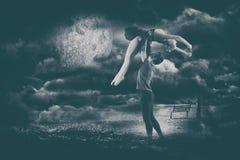 拿着芭蕾舞女演员的人的综合图象 免版税库存图片