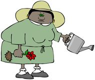 拿着花和一把喷壶的种族妇女花匠 免版税库存照片