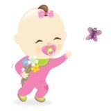 拿着花的女婴 免版税库存照片