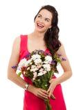 拿着花的微笑的妇女 库存照片