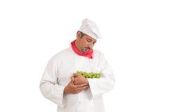 拿着葡萄的厨师 免版税库存图片