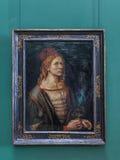 拿着蓟的艺术家的自画象或画象 库存照片
