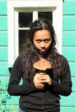 拿着蘑菇的女孩 图库摄影