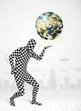 拿着行星地球的充分的身体衣服的人 免版税库存图片