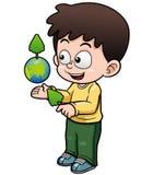 拿着行星地球的男孩 库存照片