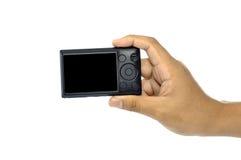 拿着袖珍相机的现有量 免版税库存照片