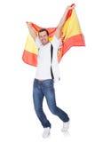 拿着西班牙标志的一个愉快的人的纵向 免版税库存图片