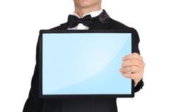 拿着触摸板的商人 免版税库存图片