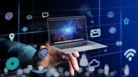 拿着计算机的商人围拢由app和社会ico 免版税库存图片