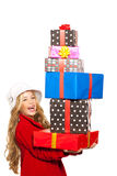 拿着许多礼品的孩子女孩被堆积在她的现有量 免版税图库摄影