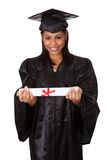 拿着证明的毕业生妇女 图库摄影