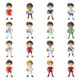 拿着足球的男孩佩带的足球球衣 免版税库存图片