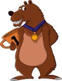 拿着金牌的逗人喜爱的棕熊 免版税库存照片
