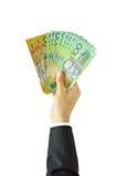 拿着金钱澳大利亚元的手 库存照片