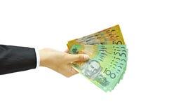 拿着金钱澳大利亚元的手 免版税库存照片