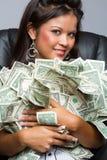 拿着金钱的妇女 库存图片