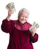 拿着金钱的微笑的老妇人 库存图片