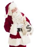 拿着金钱袋子的圣诞老人画象 免版税库存照片