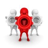 拿着钝齿轮齿轮的红色3d领导人 配合概念 库存照片