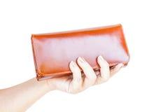 拿着钱包妇女的手 免版税图库摄影
