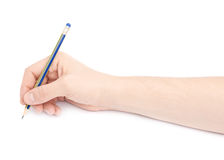 拿着铅笔的男性手 免版税库存图片