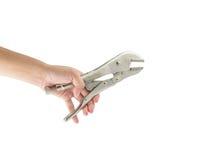 拿着锁的钳子的手被隔绝 免版税库存图片
