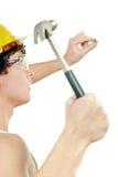 拿着锤子的工作者 免版税库存照片