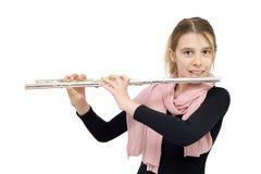 拿着长笛和微笑入照相机的年轻长笛演员 库存照片