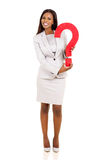 拿着问号的女实业家 免版税库存照片