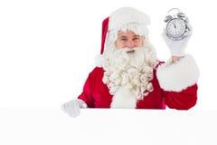 拿着闹钟和标志的圣诞老人 免版税库存图片
