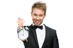 拿着闹钟的商人 免版税库存图片