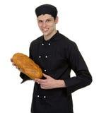 拿着面包的贝克 图库摄影