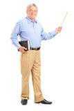 拿着鞭子和书的男性教师 免版税库存图片