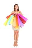 拿着顾客购物妇女的袋子 免版税图库摄影