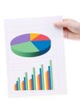拿着颜色图表文件的手 免版税图库摄影