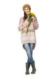 拿着黄色花的微笑的女孩 图库摄影