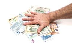 拿着货币的现有量 免版税库存照片
