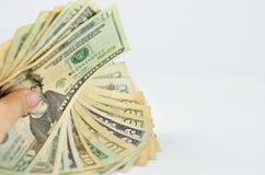 拿着货币的现有量 库存照片