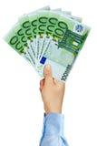 拿着100张欧洲钞票的爱好者商人手 免版税库存照片