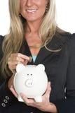 拿着贪心妇女的银行 免版税库存图片
