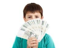拿着从捷克冠钞票的男孩一个爱好者 库存图片