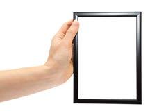 拿着黑暗的木照片框架的妇女手 库存图片