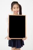 拿着黑板学生的亚洲女孩手显示黑板 库存图片