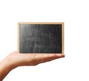 拿着黑板手中 库存照片