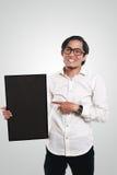 拿着黑板的亚洲商人 库存图片