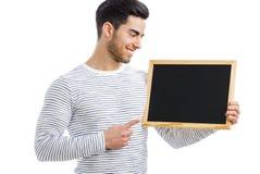 拿着黑板的人 库存照片